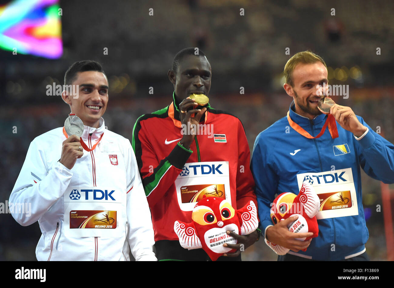 Beijing, China. 26th Aug, 2015. Gold medalist Kenya's David Lekuta Rudisha (C), silver medalist Poland's - Stock Image