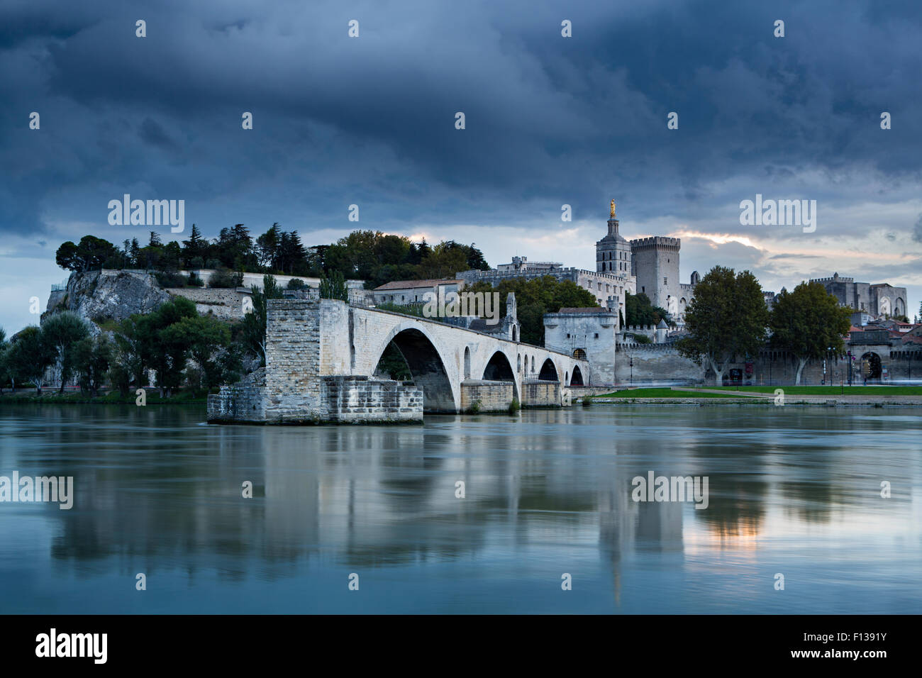The Pont St-Benezet, Palais des Papes and Rhone River at dusk, Avignon, Provence, France, October 2012. - Stock Image