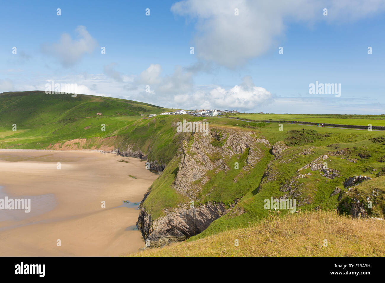 Rhossili coast The Gower peninsula South Wales one of the best beaches in the UK in summer with blue sky - Stock Image