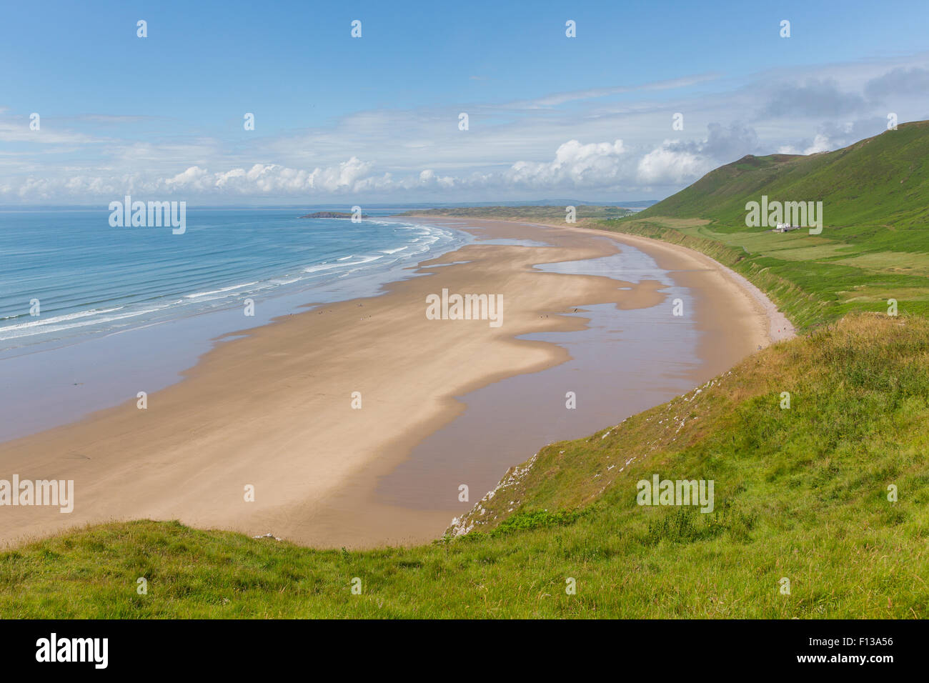 The Gower coast South Wales Rhossili beach one of the best beaches in the UK in summer with blue sky - Stock Image