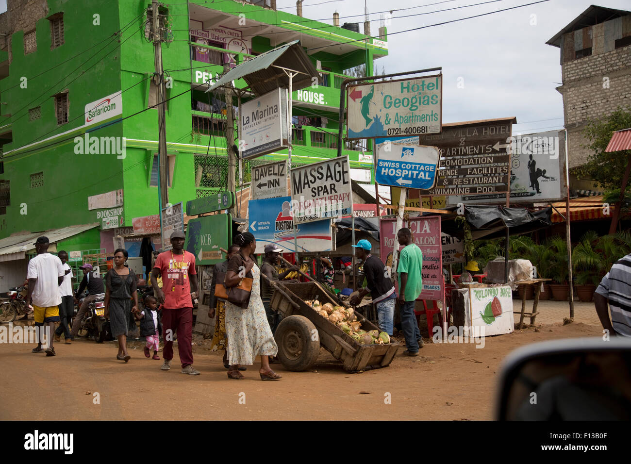 Busy street with advertising hoardings and billboards Mtwapa Mombasa Kenya - Stock Image
