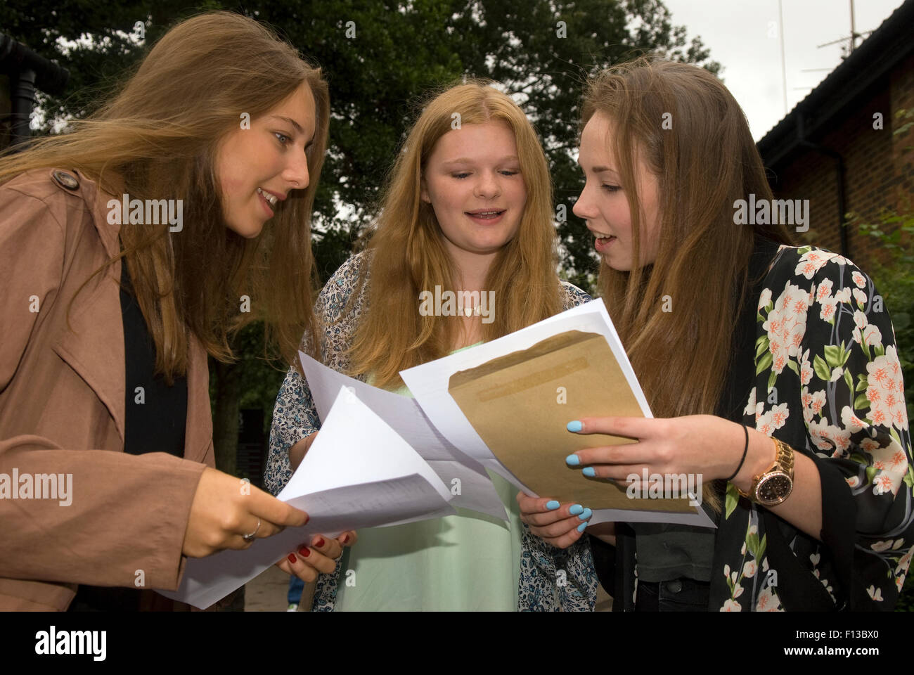 Pupil's with their GCSE exam results at their school on results day, Liphook, Hampshire, UK. - Stock Image
