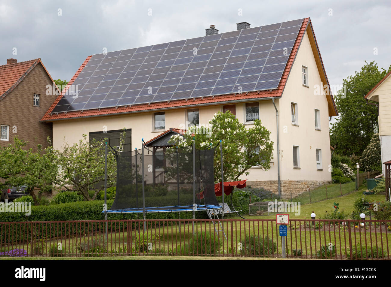 Photovoltaic solar PV panels on roof of private house Germany - Stock Image