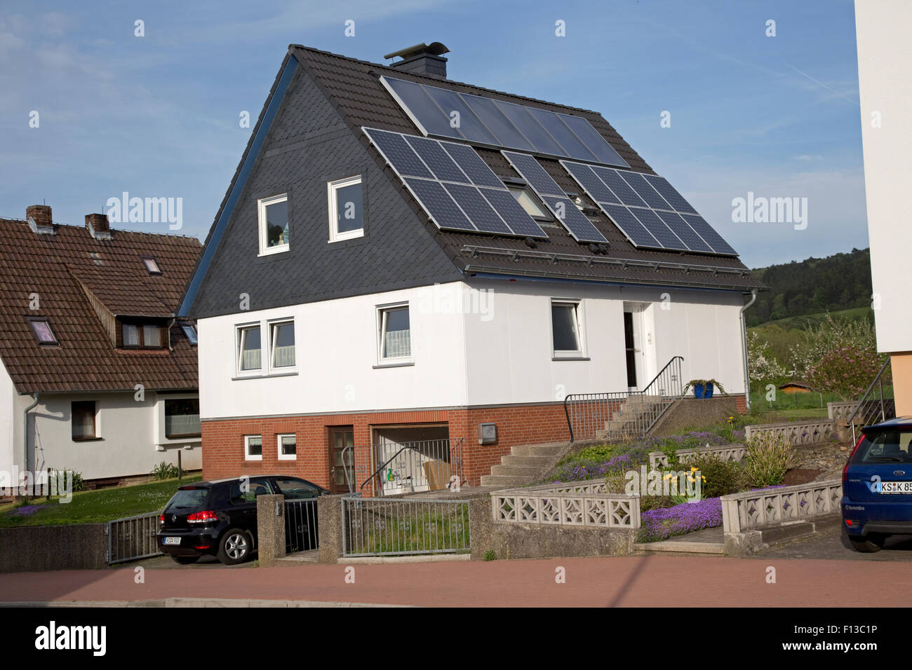 Photovoltaic solar panels PV roof on private house Germany - Stock Image