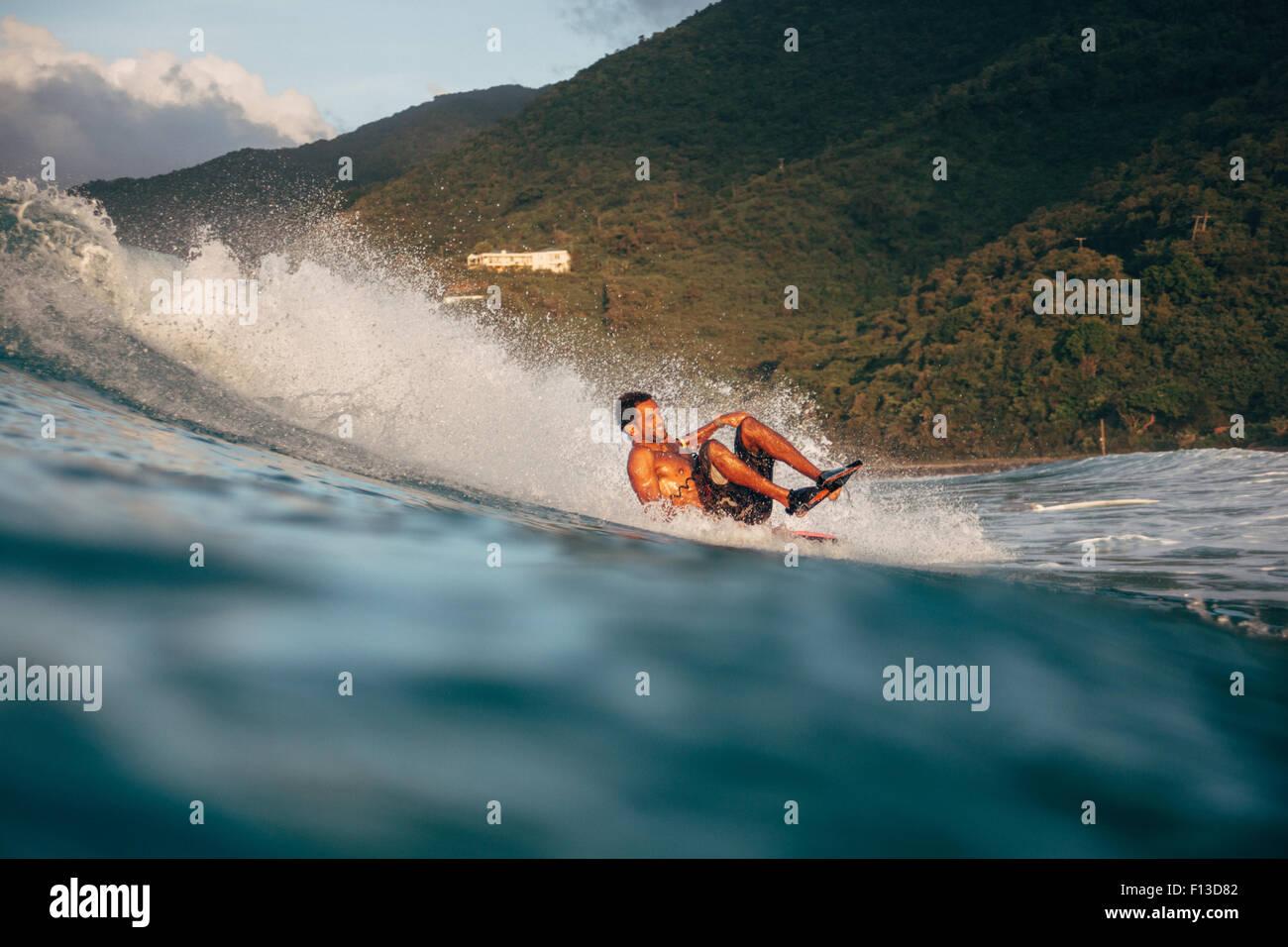 Man bodyboarding in the Caribbean - Stock Image