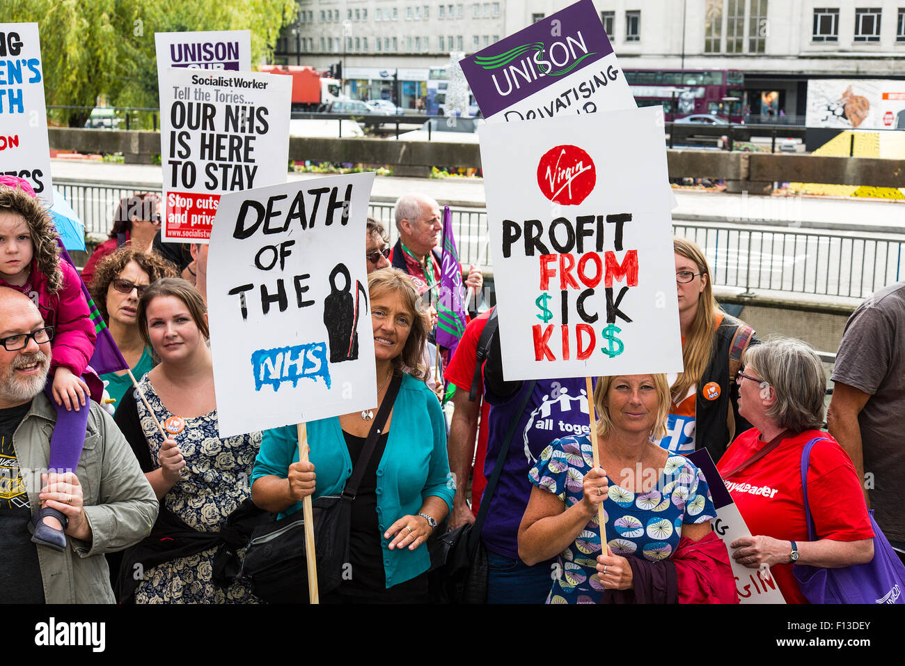Bristol, UK. 26th Aug, 2015. Approx 300 protesters marched to Bristol NHS Commissioning Group offices demanding - Stock Image