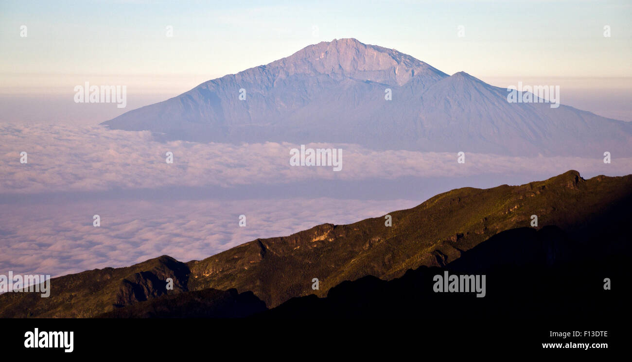 Mount Meru at sunrise seen from Mount Kilimanjaro, Tanzania - Stock Image