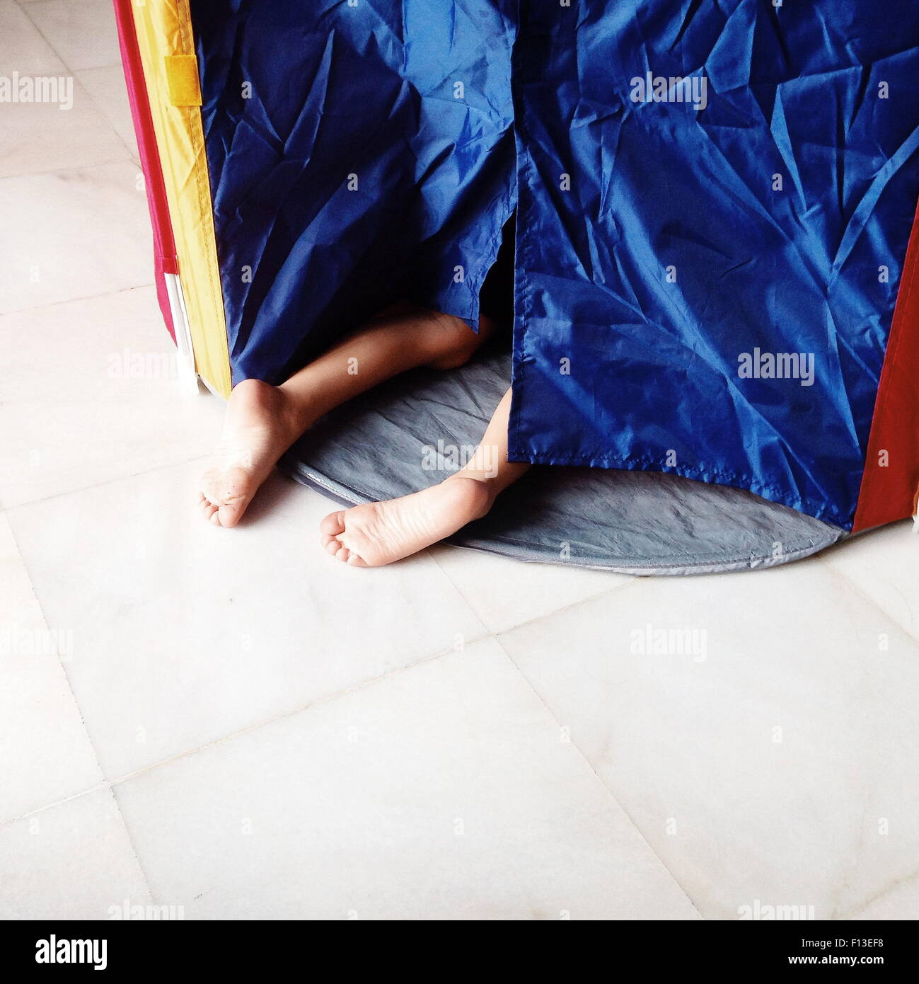 Boy crawling into a tent - Stock Image