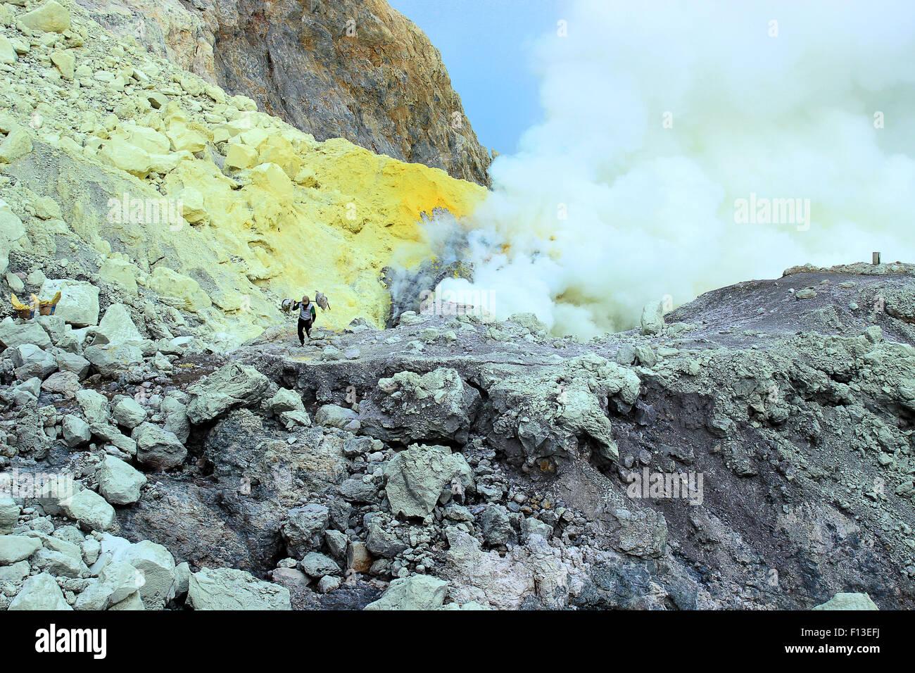 Sulphur Farmer carrying sacks, Ijen Crater, East Java,  Indonesia - Stock Image