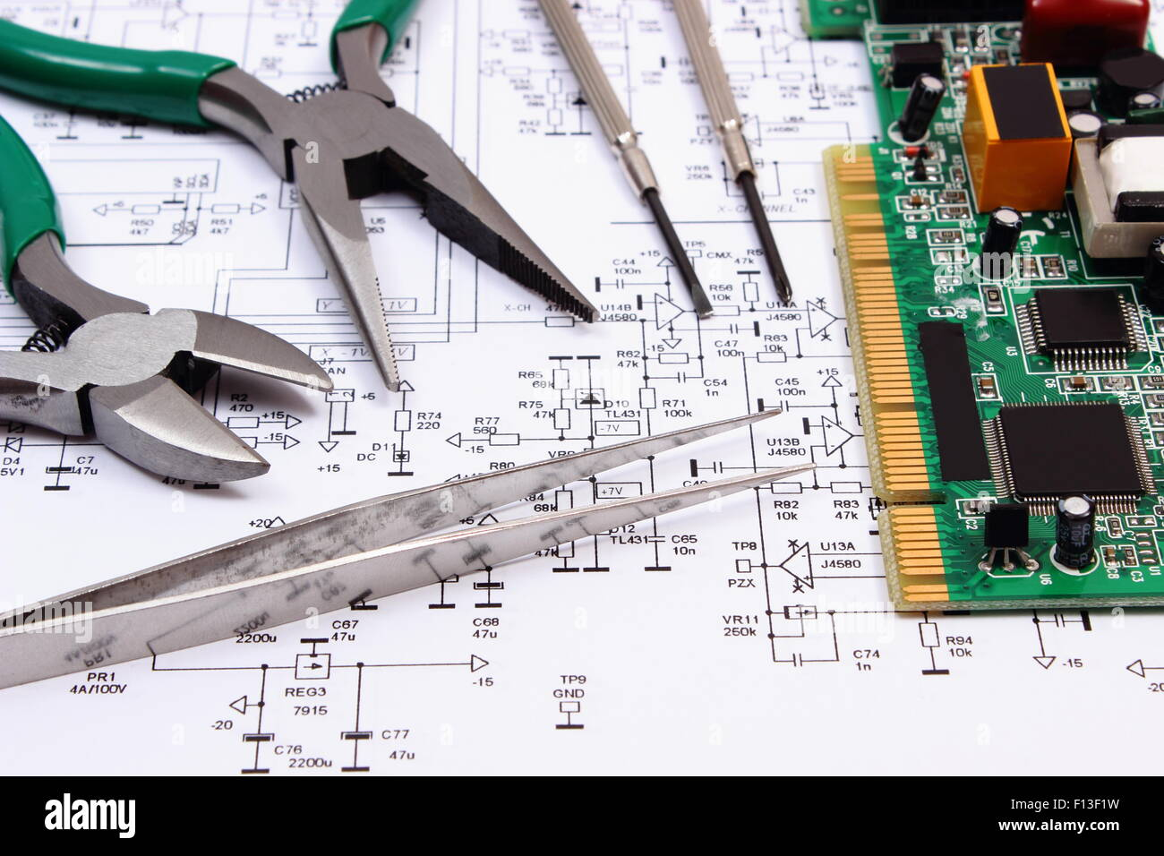 Printed circuit board with electrical components and precision tools ...