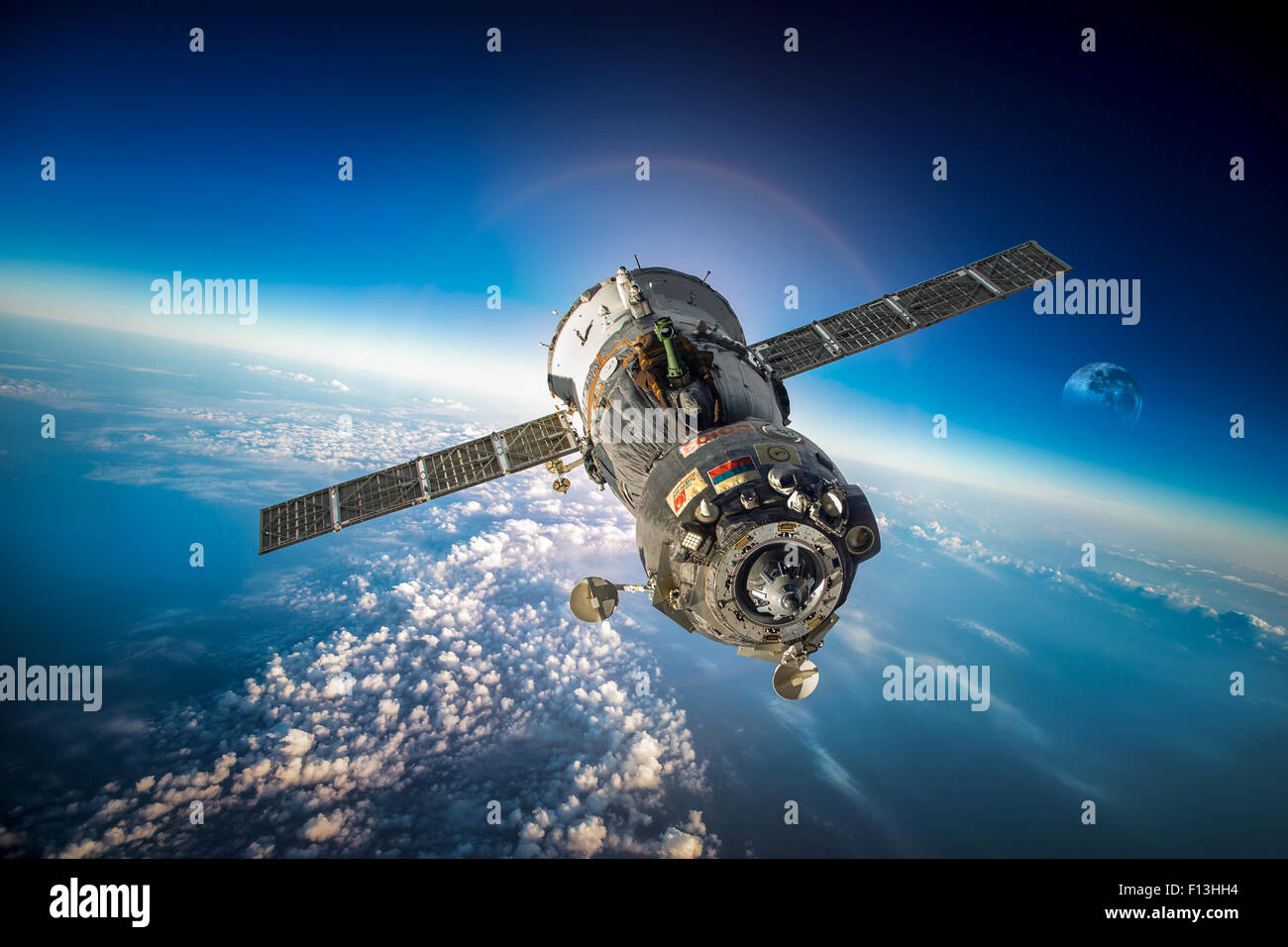 Spacecraft Soyuz orbiting the earth. Elements of this image furnished by NASA. - Stock Image