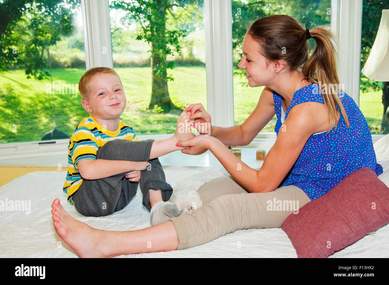 Samus Feet Tickle: Two Children Tickling Feet Stock Photo: 86746410