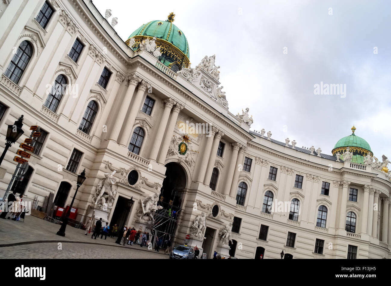 Vienna, facade of the Hofburg on Michaelerplatz. Hofburg Palace is the former imperial palace in the centre of Vienna. - Stock Image