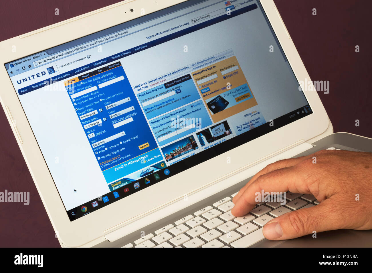 Website belonging to United Airlines being viewed on a laptop computer - Stock Image