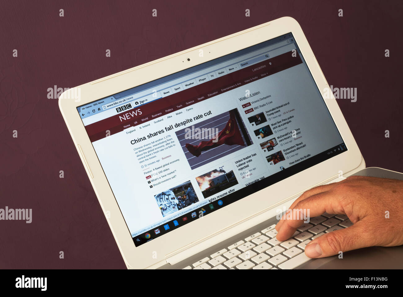 Website belonging to BBC News being viewed on a laptop computer - Stock Image