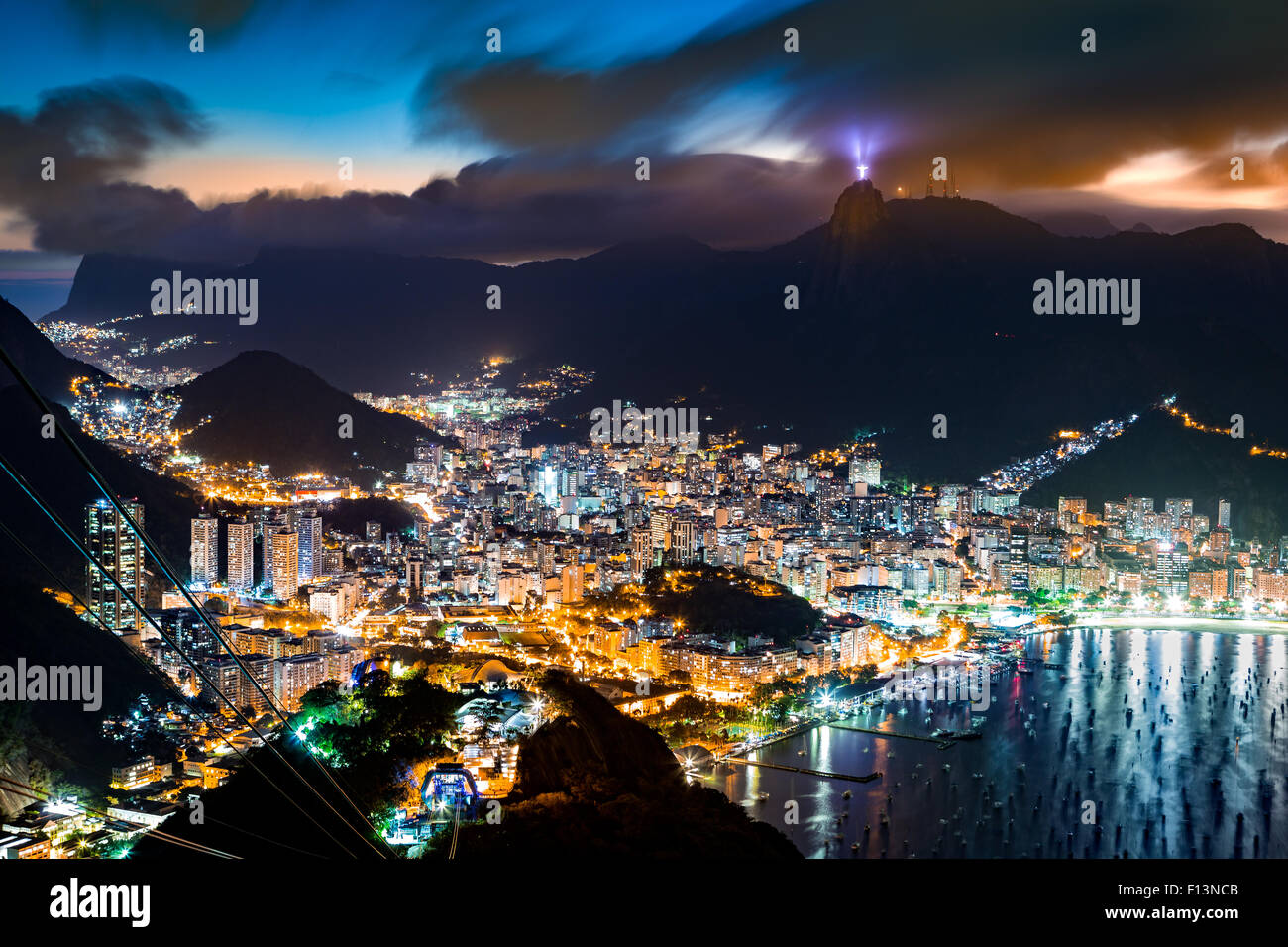 Aerial view over Rio de Janeiro on a hazy night, as viewed from Sugar Loaf peak. - Stock Image
