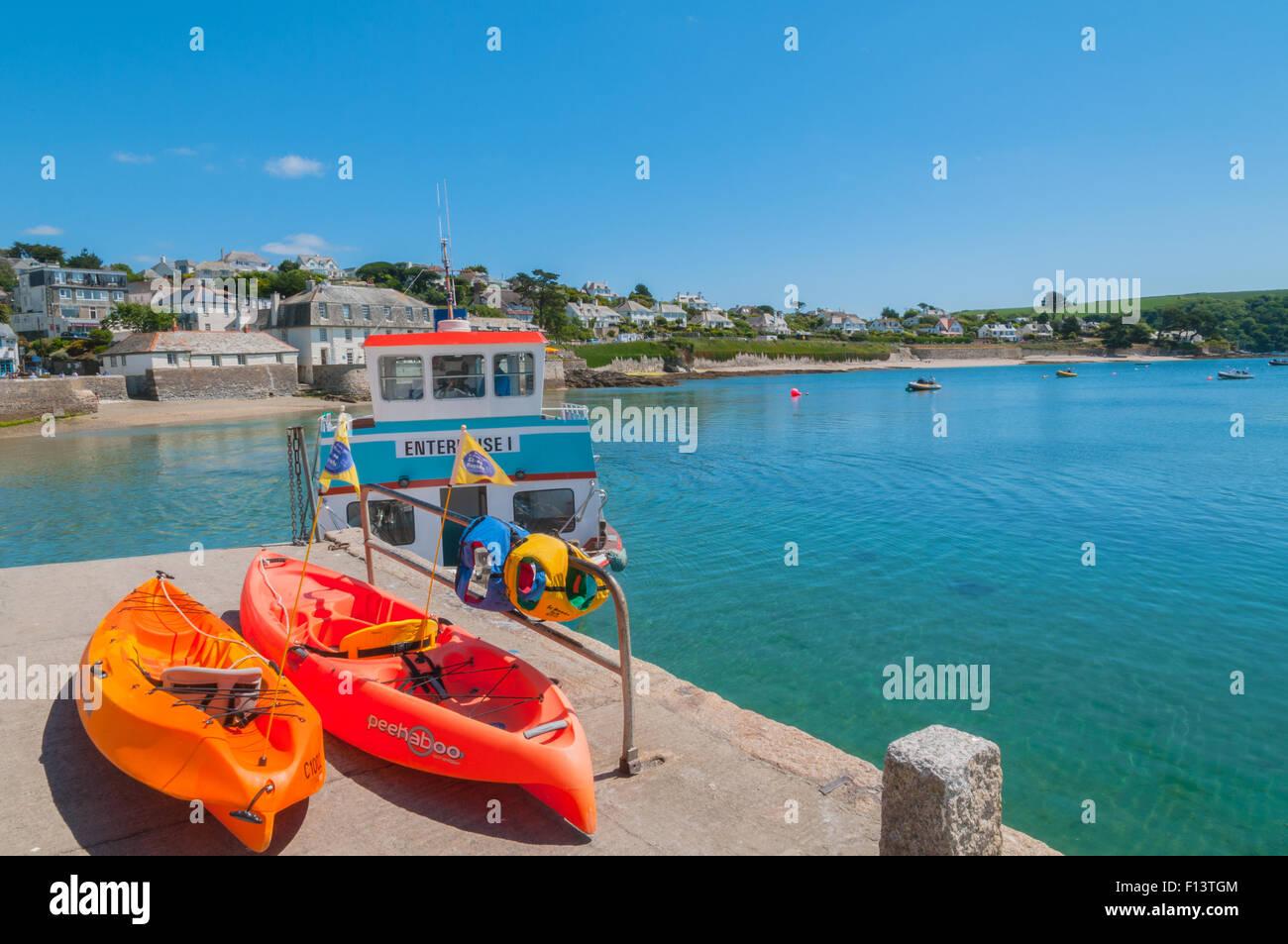 Pleasure Boat and Sea Kayaks at St Mawes Cornwall England - Stock Image