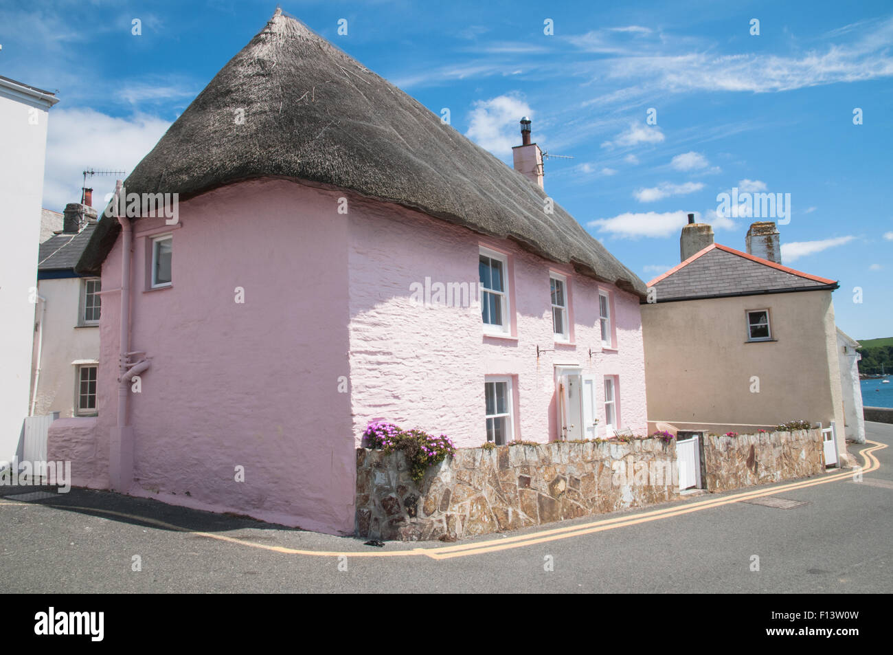 Thatched Pink Cottage and old fishermens cottage St Mawes Cornwall England - Stock Image