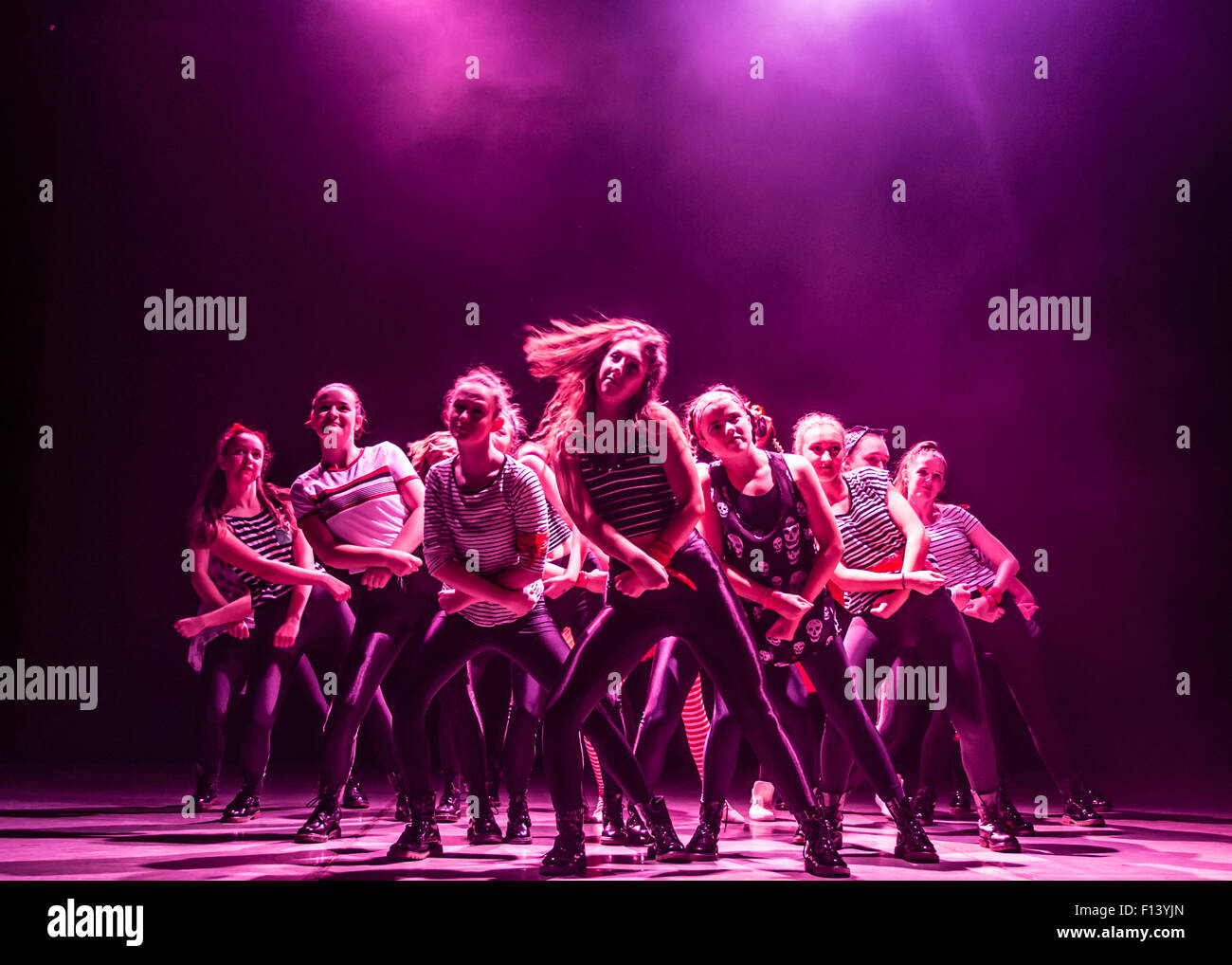 A group of young teenage girl student modern dance dancers at Aberystwyth Arts Centre  Dance School dancing on stage - Stock Image