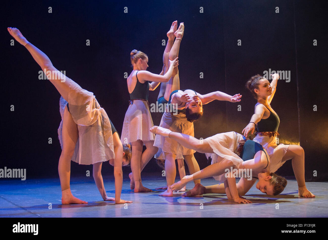 A group of young teenage girl student ballet dancers at Aberystwyth Arts Centre  Dance School dancing on stage in - Stock Image