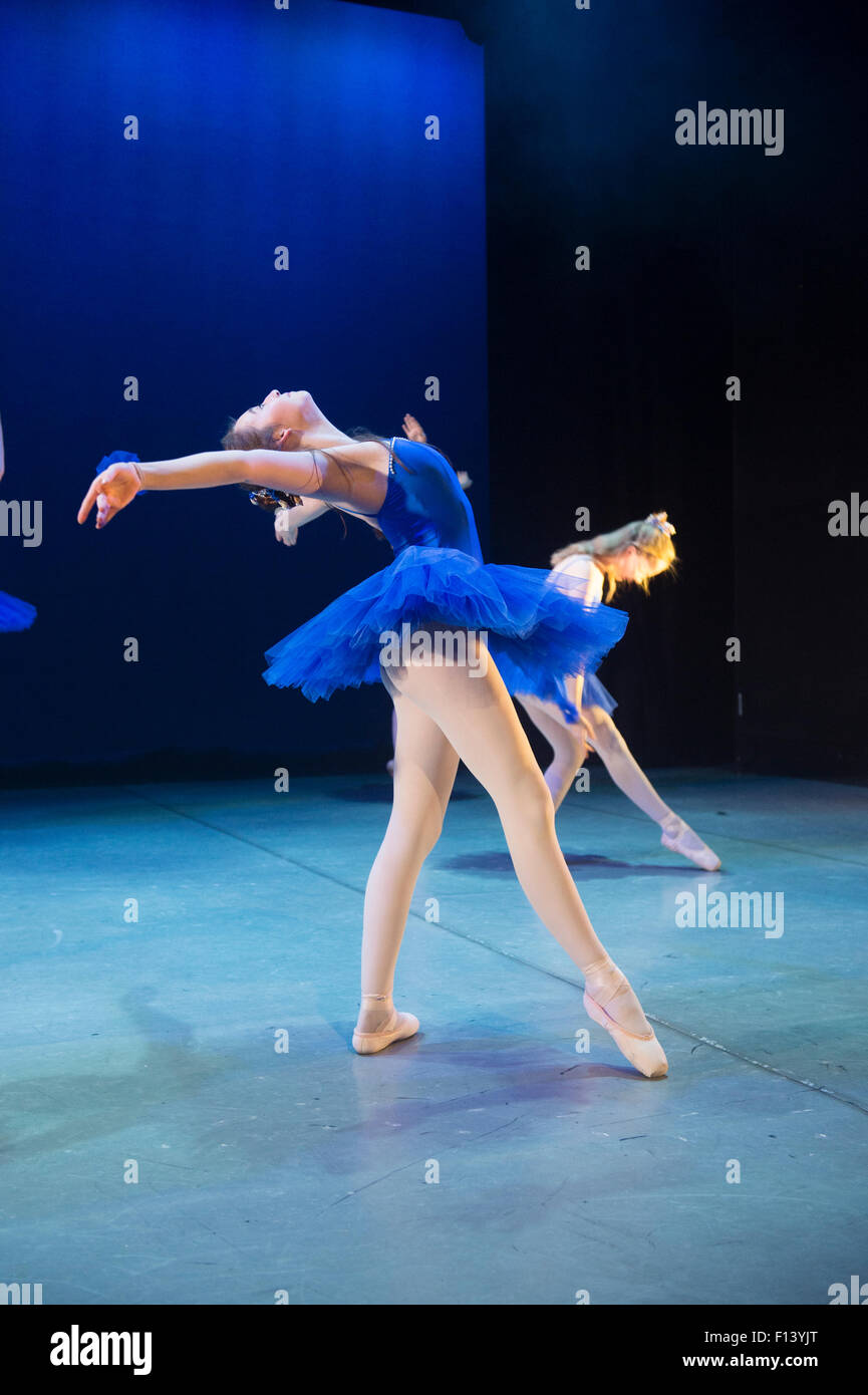 Two Young teenage girl student ballet dancers wearing blue tutus at Aberystwyth Arts Centre  Dance School dancing - Stock Image
