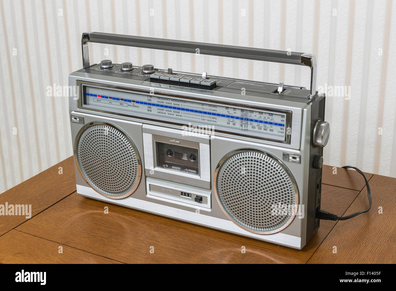 Old boom box radio cassette recorder on wood table. - Stock Image