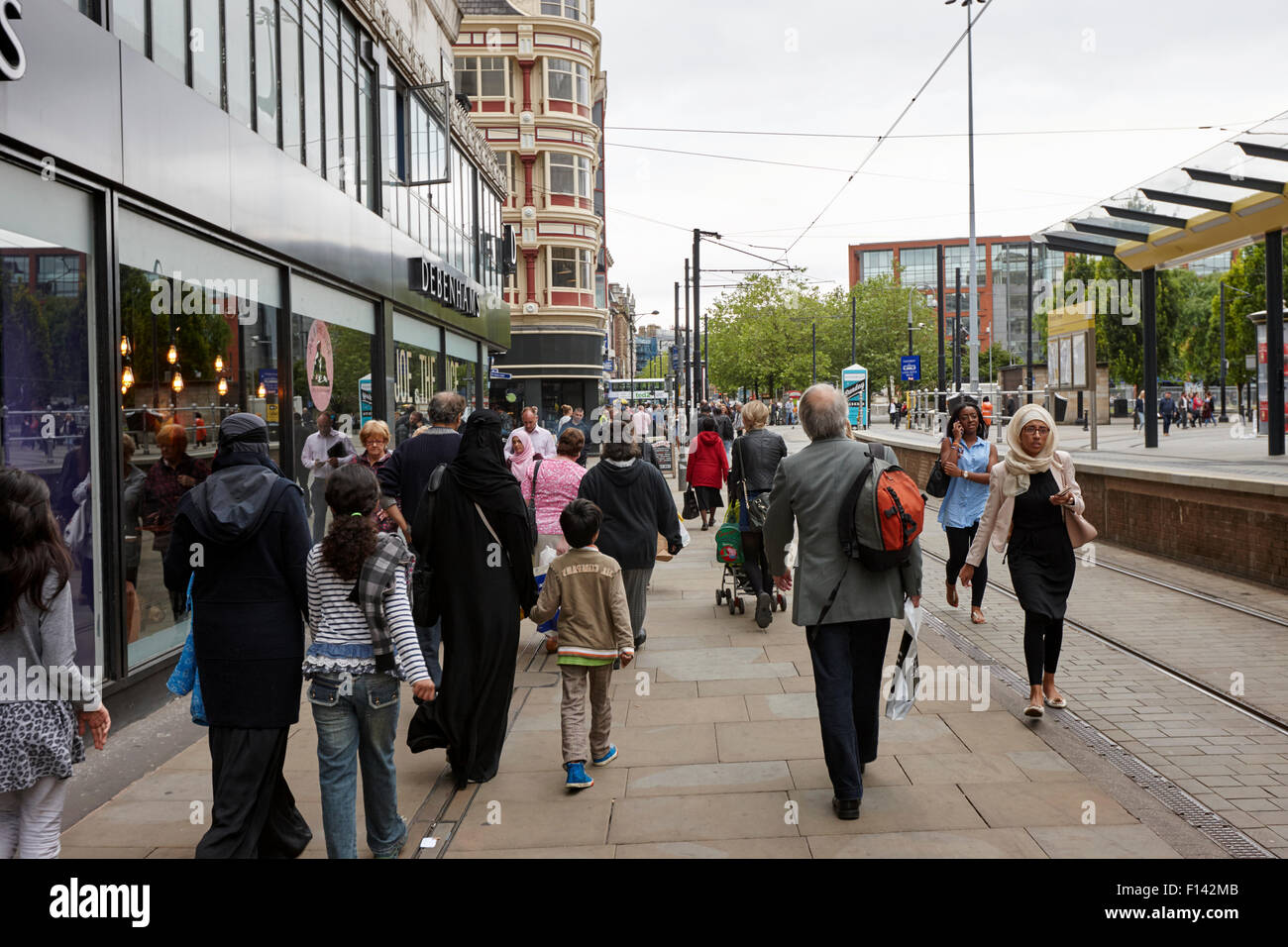 multi cultural and multi ethnic shoppers in city centre Manchester UK - Stock Image