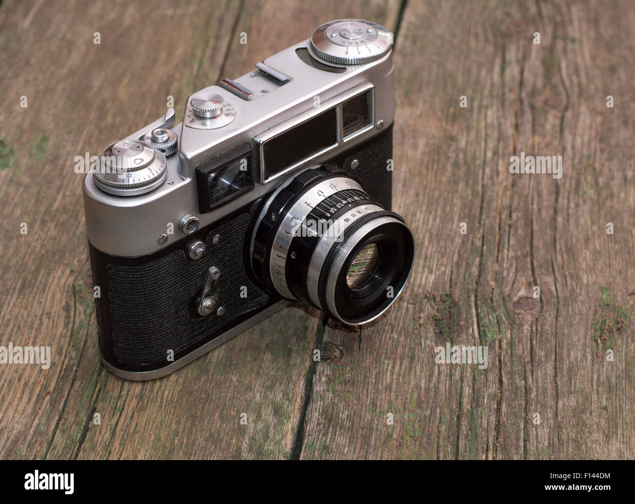 retro the camera on an old wooden table - Stock Image