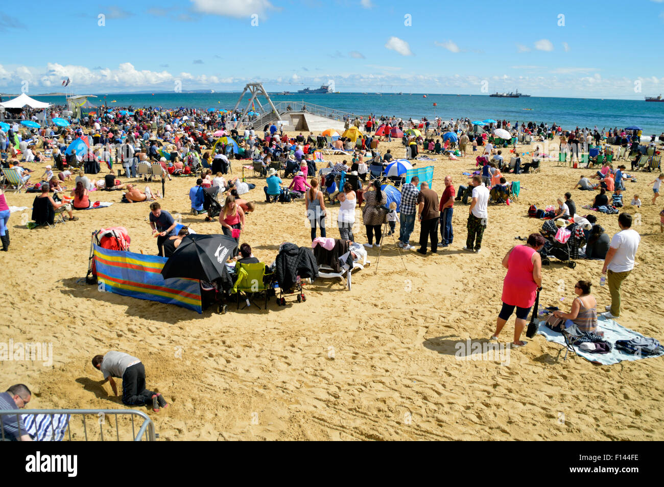 Crowds sunbathing on Bournemouth Beach on a hot summers day in August - Stock Image