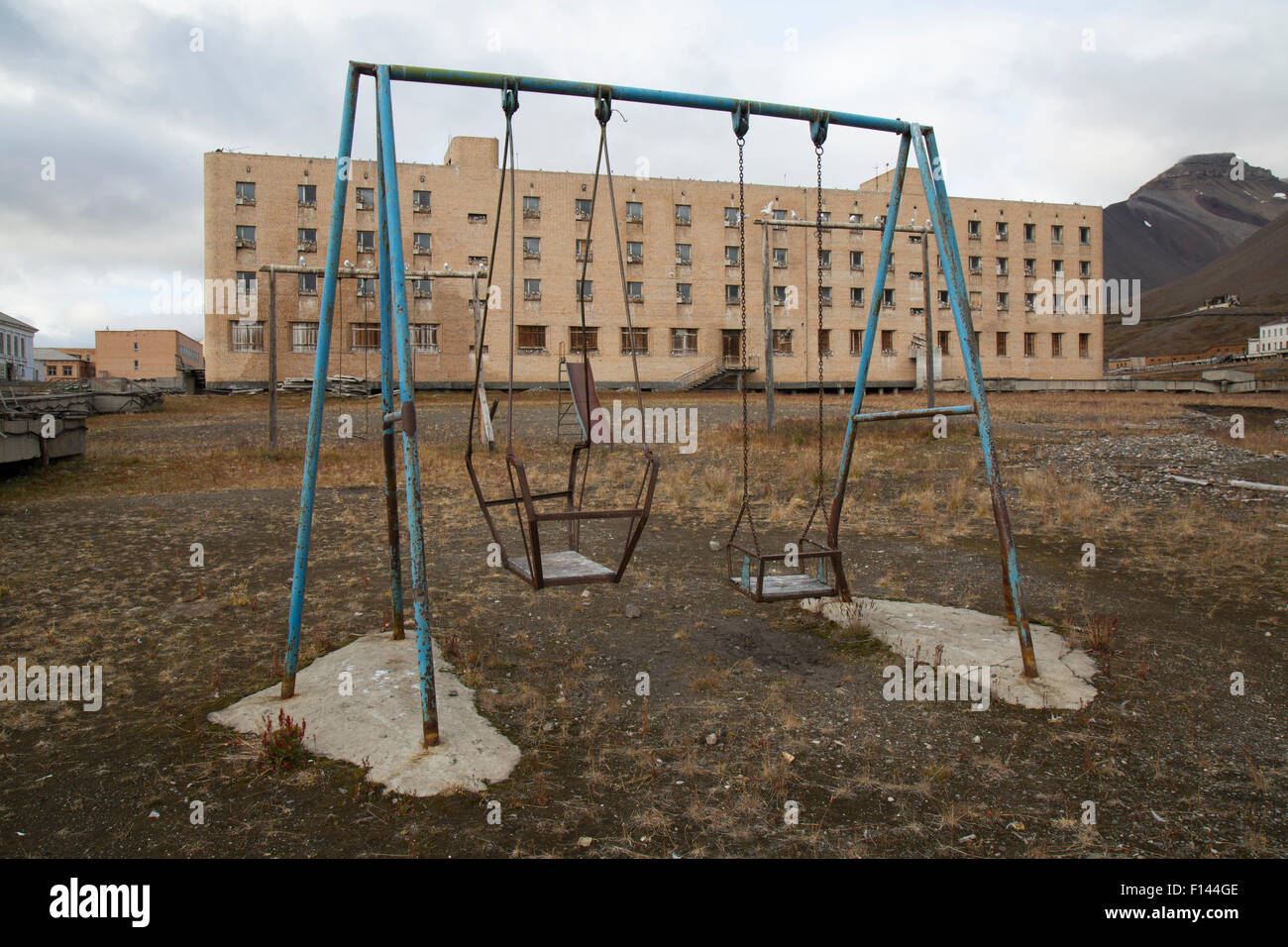 A Child S Playground And Apartment Block In The Abandoned Mining Town Stock Photo Alamy