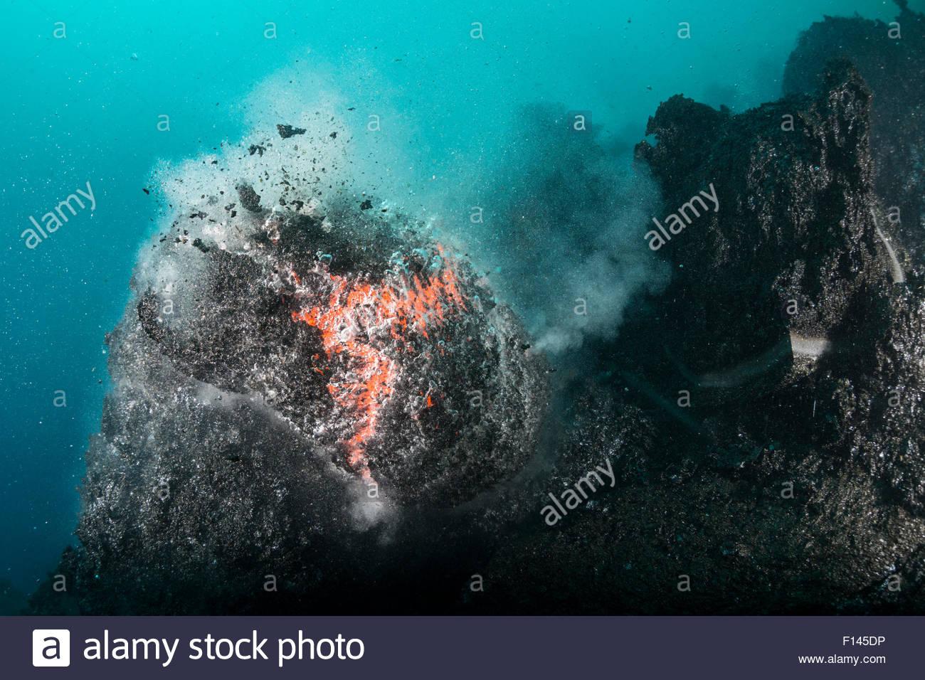 hot lava from kilauea volcano erupting underwater as