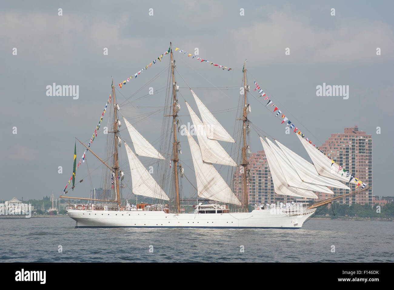 Cisne Branco, a tall ship belonging to the Brazilian Navy, during Op Sail 2012, going up the Hudson River. - Stock Image