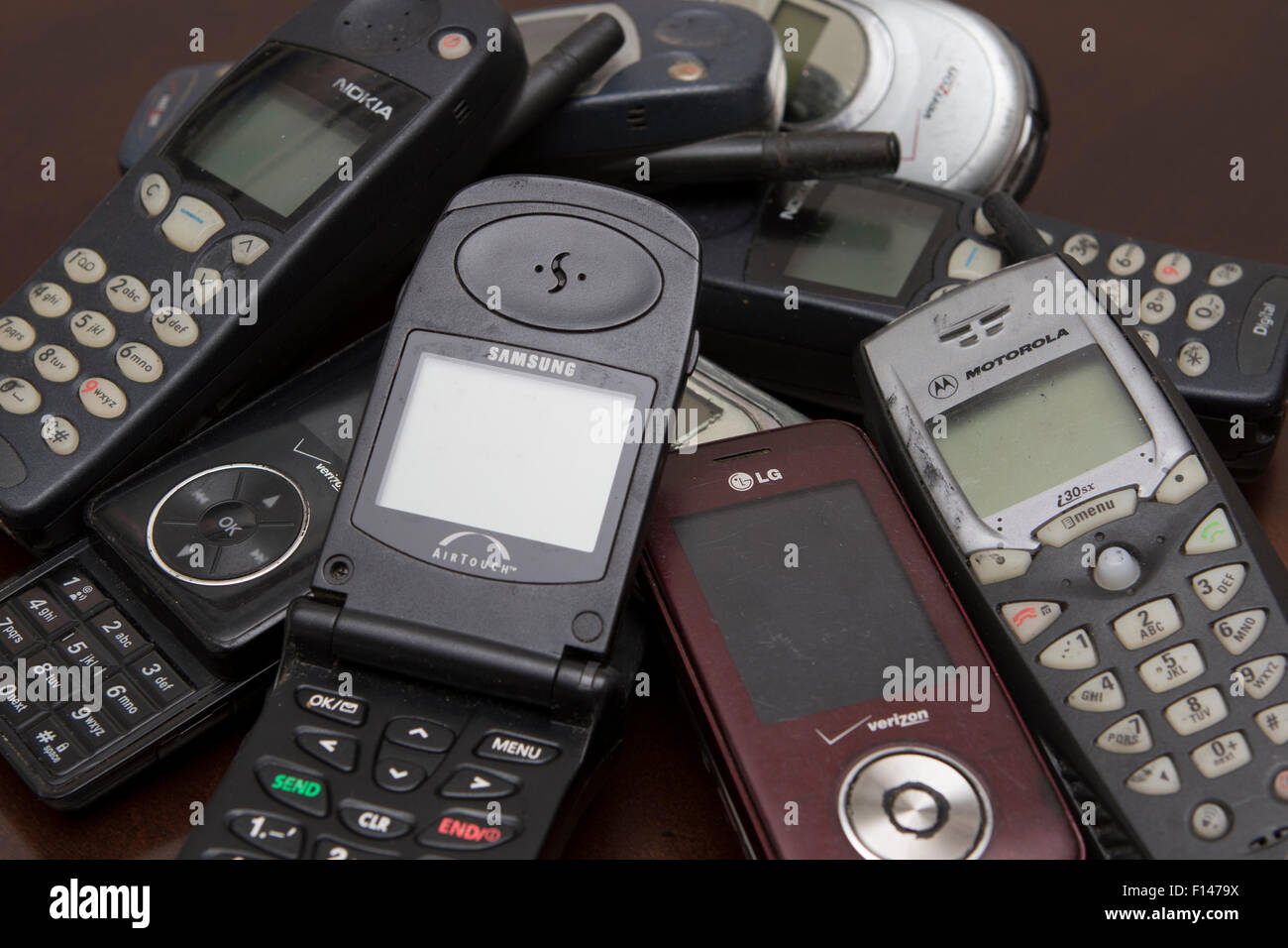 An assortment of old cell phones - Stock Image