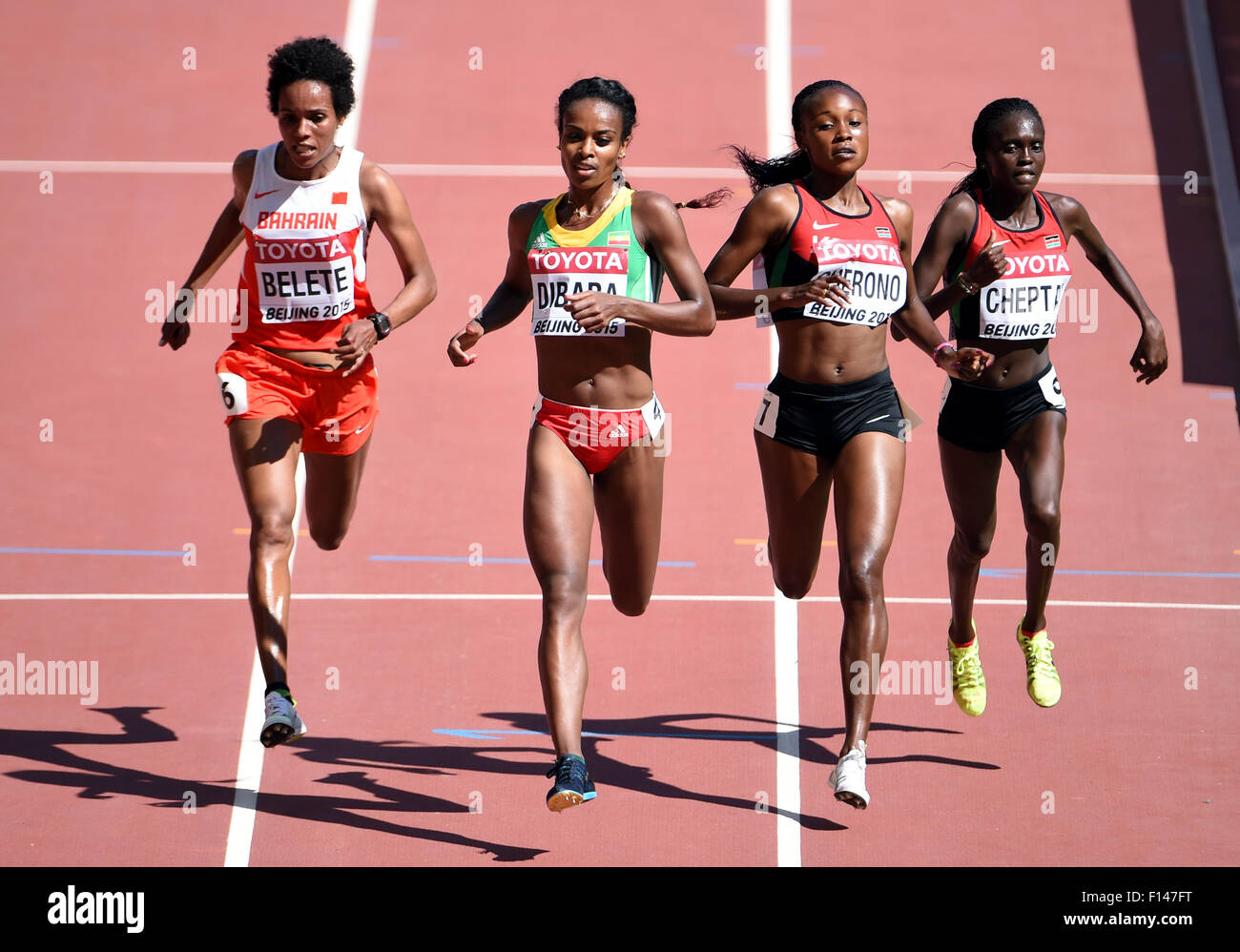 Beijing, China. 27th Aug, 2015. Genzebe Dibaba (2nd L) of Ethiopia competes during the women's 5000m heat at the Stock Photo