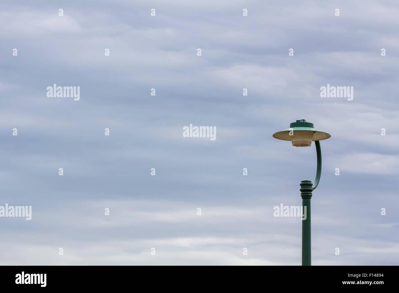 Street light seen on a cloudy day. Brisbane, Queensland, Australia. - Stock Image