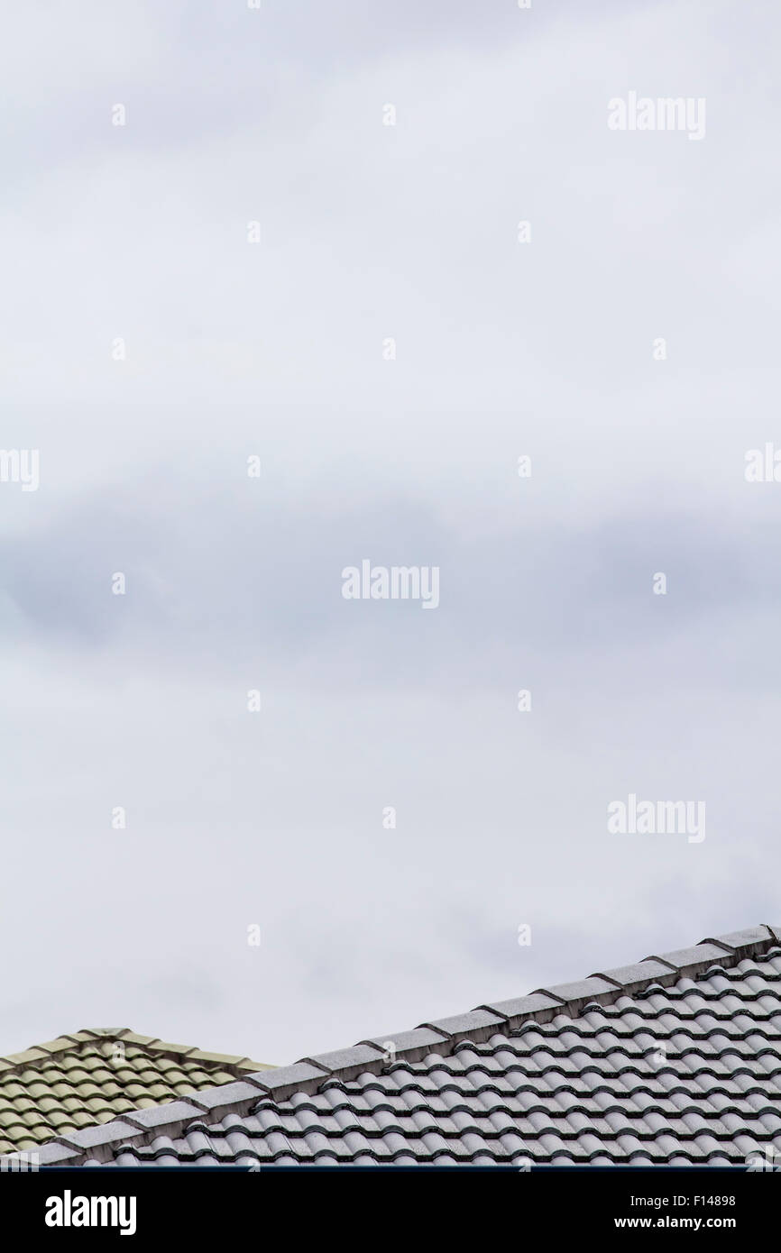 Suburban house roofs seen on a cloudy day. Brisbane, Queensland, Australia. - Stock Image