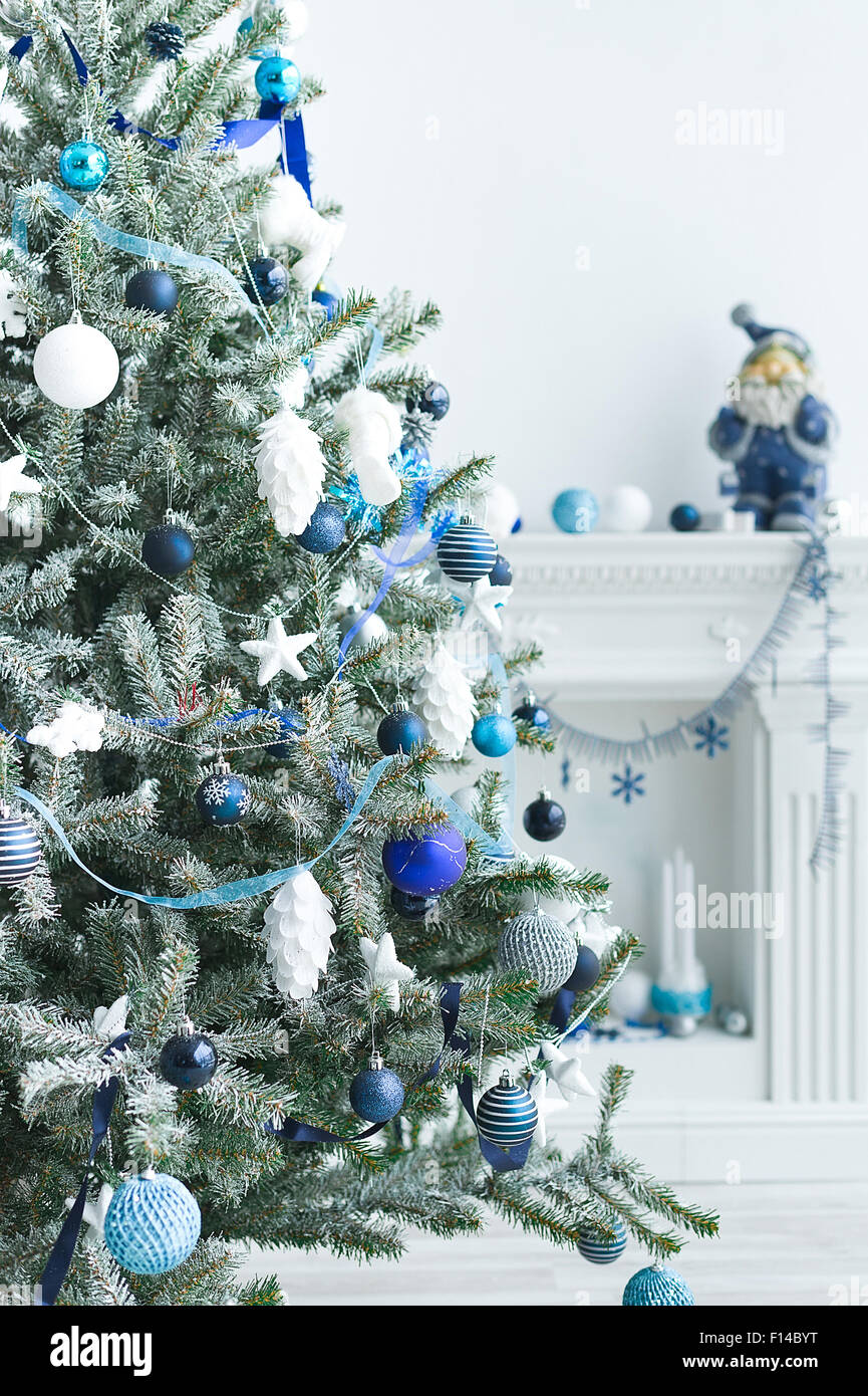 Christmas Tree With Blue And White Toys In The Interior Christmas