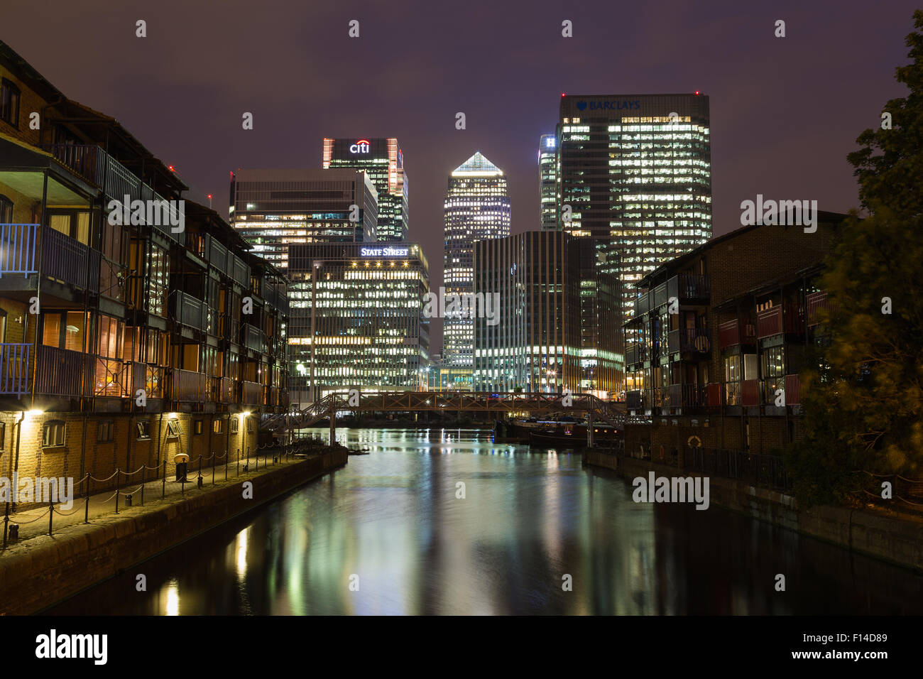 LONDON, UK - 16TH JULY 2015: The outside of Canary Wharf in London at night showing the office buildings and reflections Stock Photo