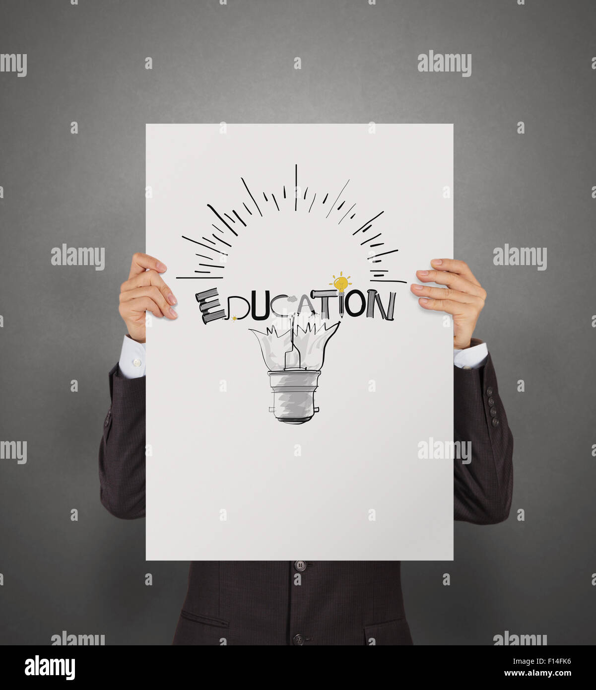 business man showing hand drawn graphic design education word and