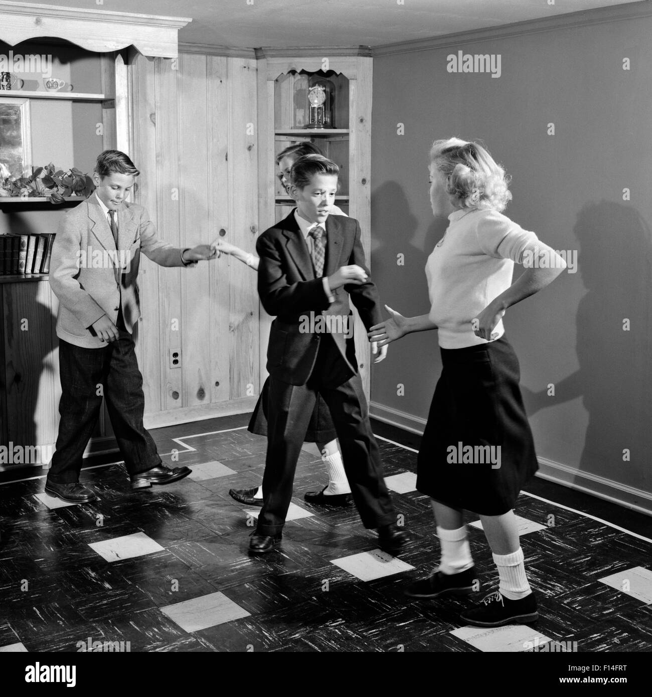 1950s Four Teenage Boys And Girls Dancing Party Stock