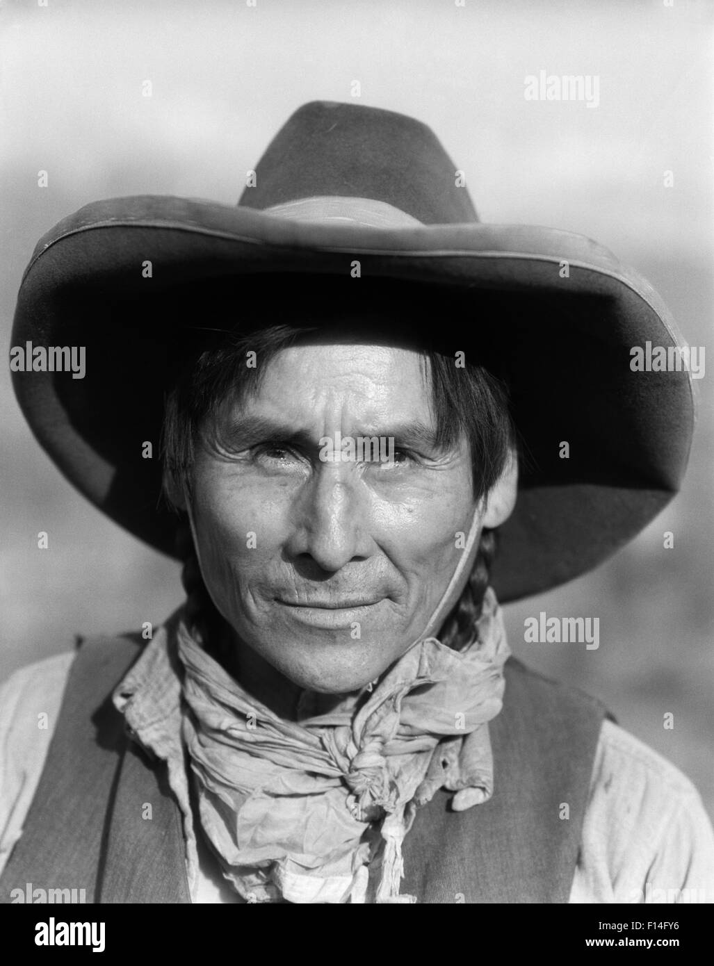 1920s SMILING NATIVE AMERICAN STONEY SIOUX INDIAN MAN WESTERN TRAIL GUIDE  WEARING COWBOY HAT LOOKING AT CAMERA ALBERTA CANADA 4c8892baab9