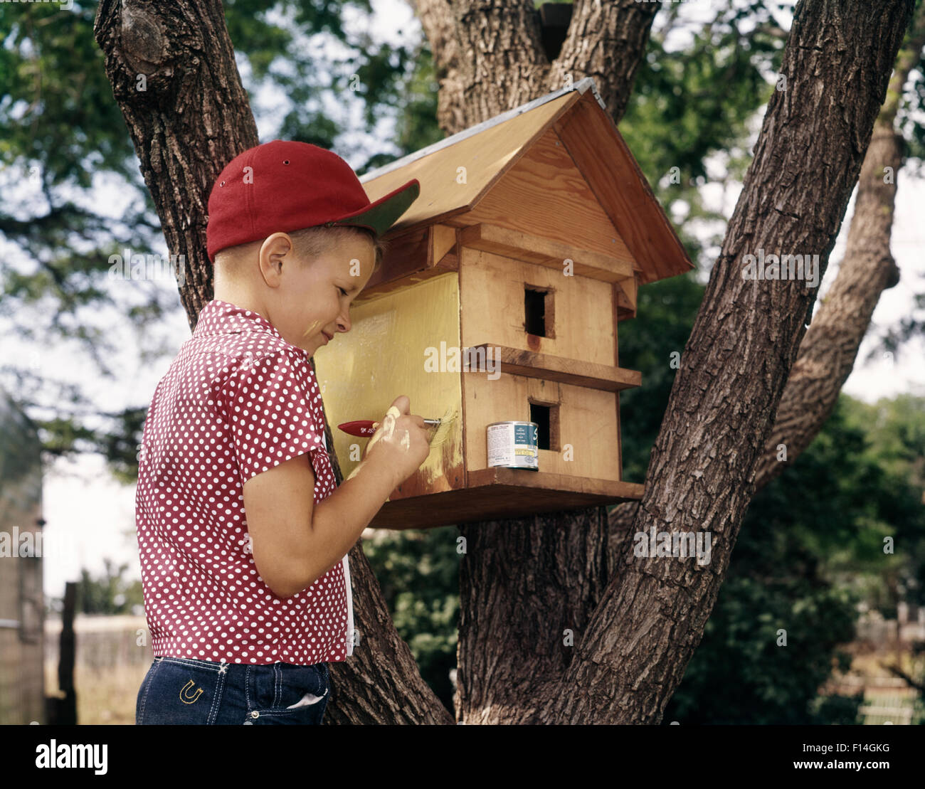 Marvelous 1970S 1980S Boy Painting Bird House Wearing Red Baseball Cap Download Free Architecture Designs Scobabritishbridgeorg