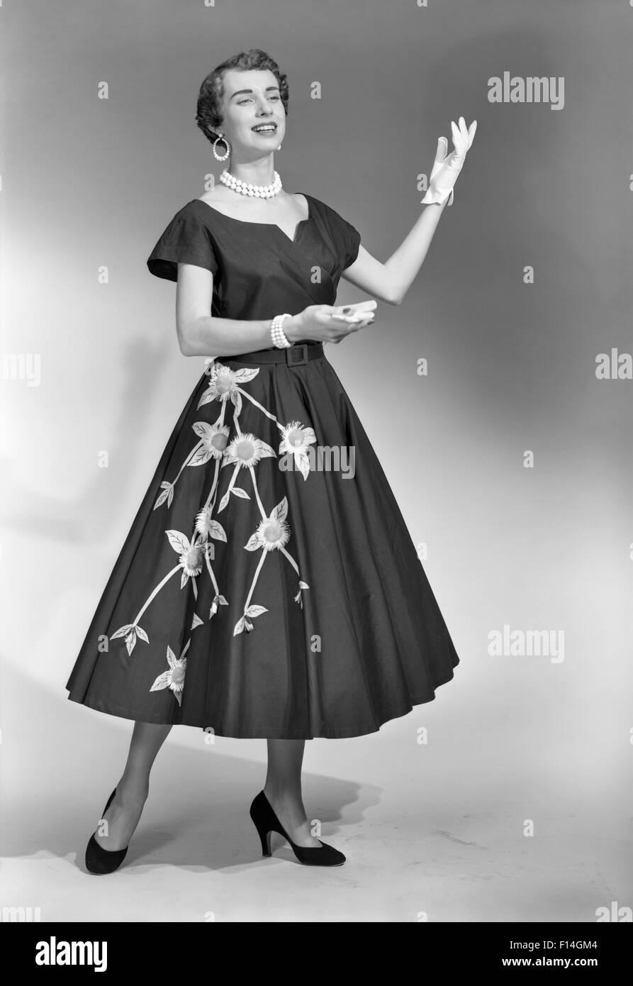 b6cbfe58933 1950s BRUNETTE WOMAN WEARING BLACK DRESS WITH FLOWERS GLOVES PEARL CHOKER