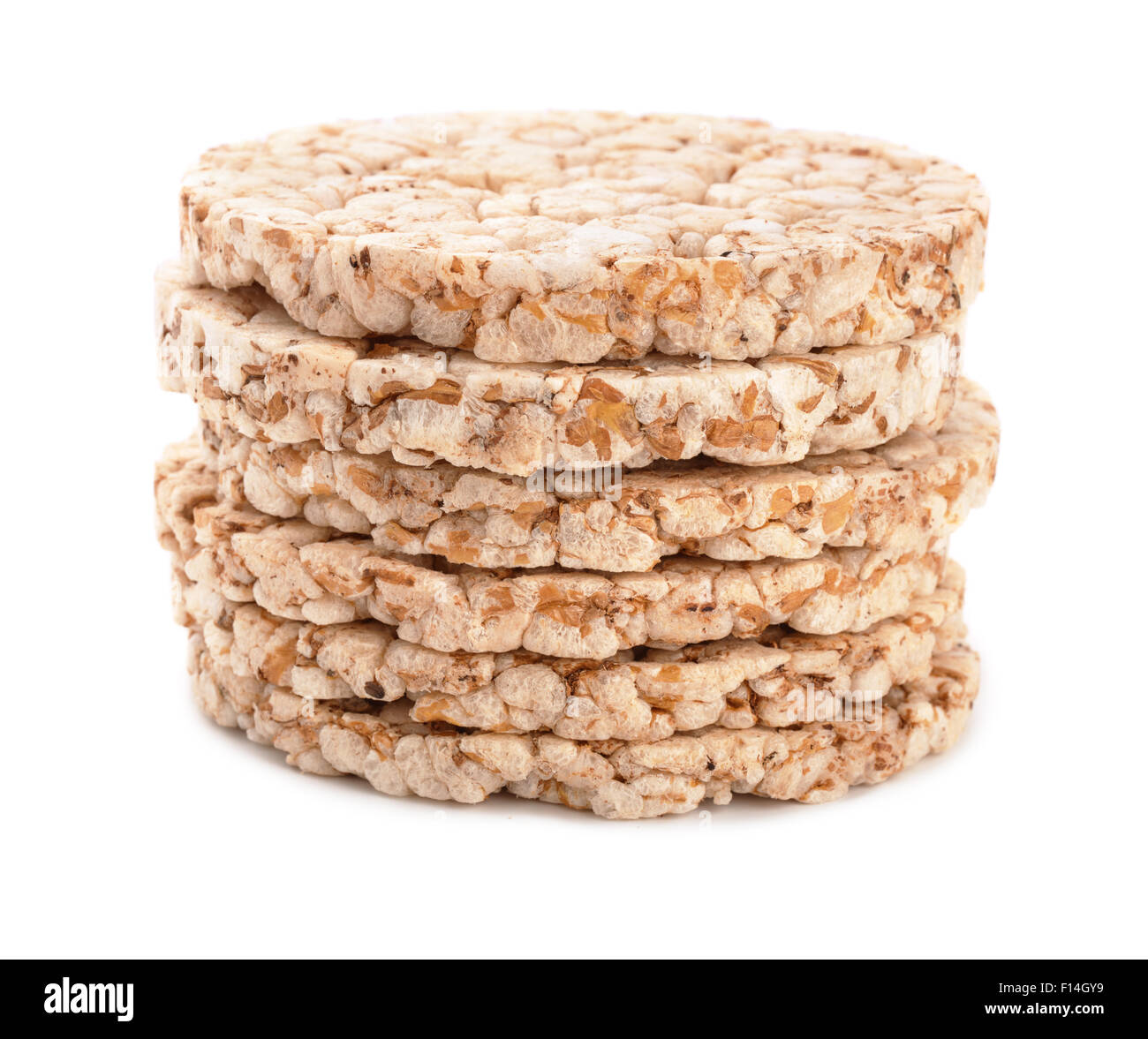 Stack of puffed whole grain crispbread isolated on white - Stock Image