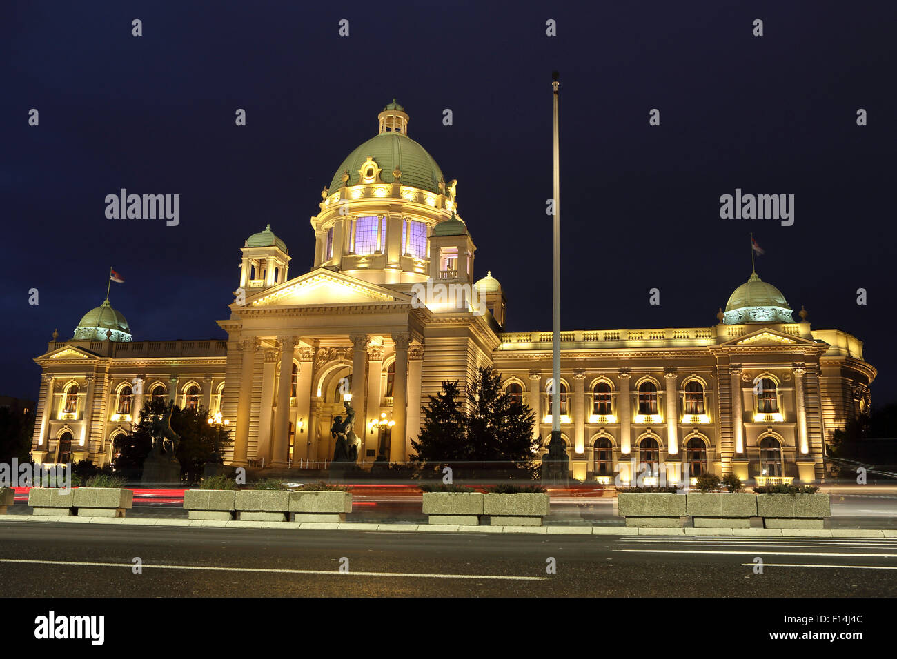 The Serbian Parliament building in Belgrade, Serbia. The building is illuminated. - Stock Image