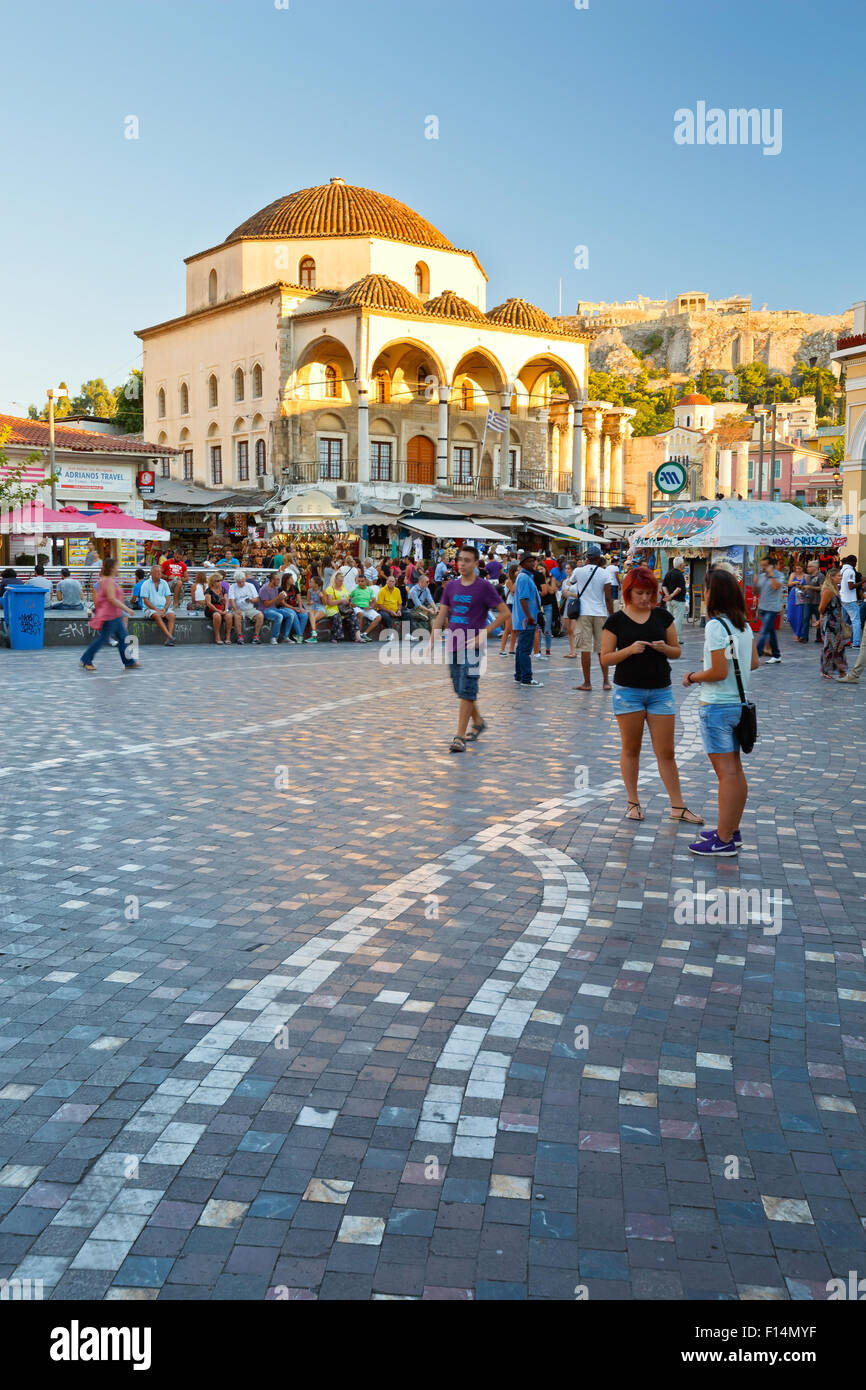 People at the mosque and metro station in Monastiraki square in Athens - Stock Image