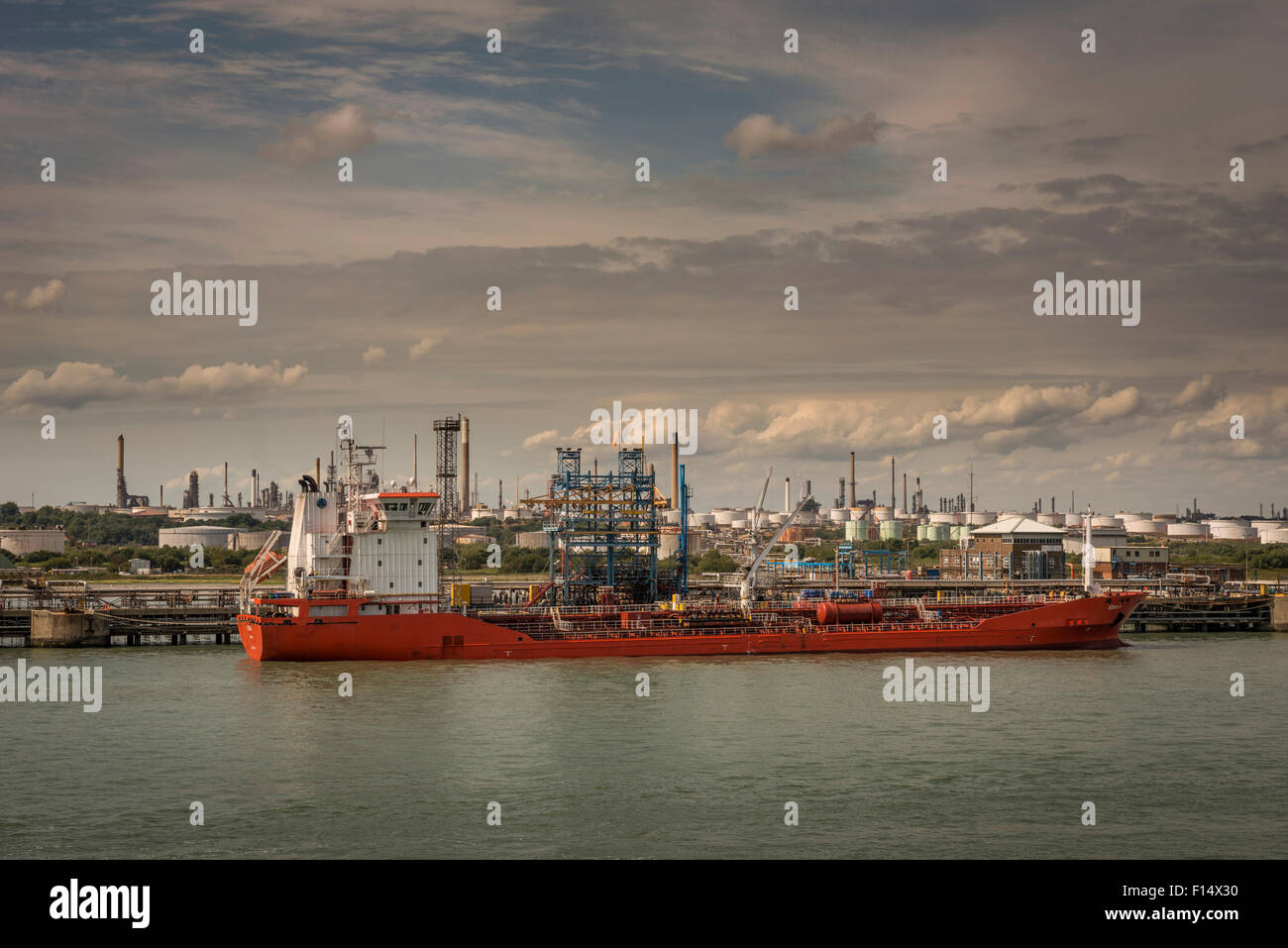 An oil tanker docked at Fawley Oil Refinery near Southampton, Hampshire, UK Stock Photo