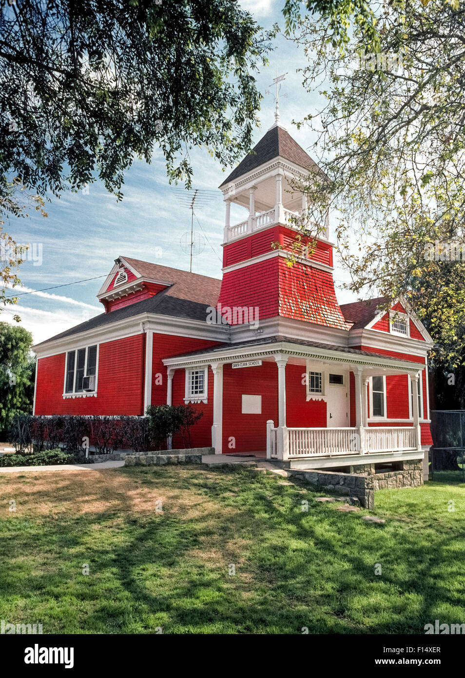 The historic little red Santa Clara School was built in 1896 and still serves elementary students in kindergarten Stock Photo
