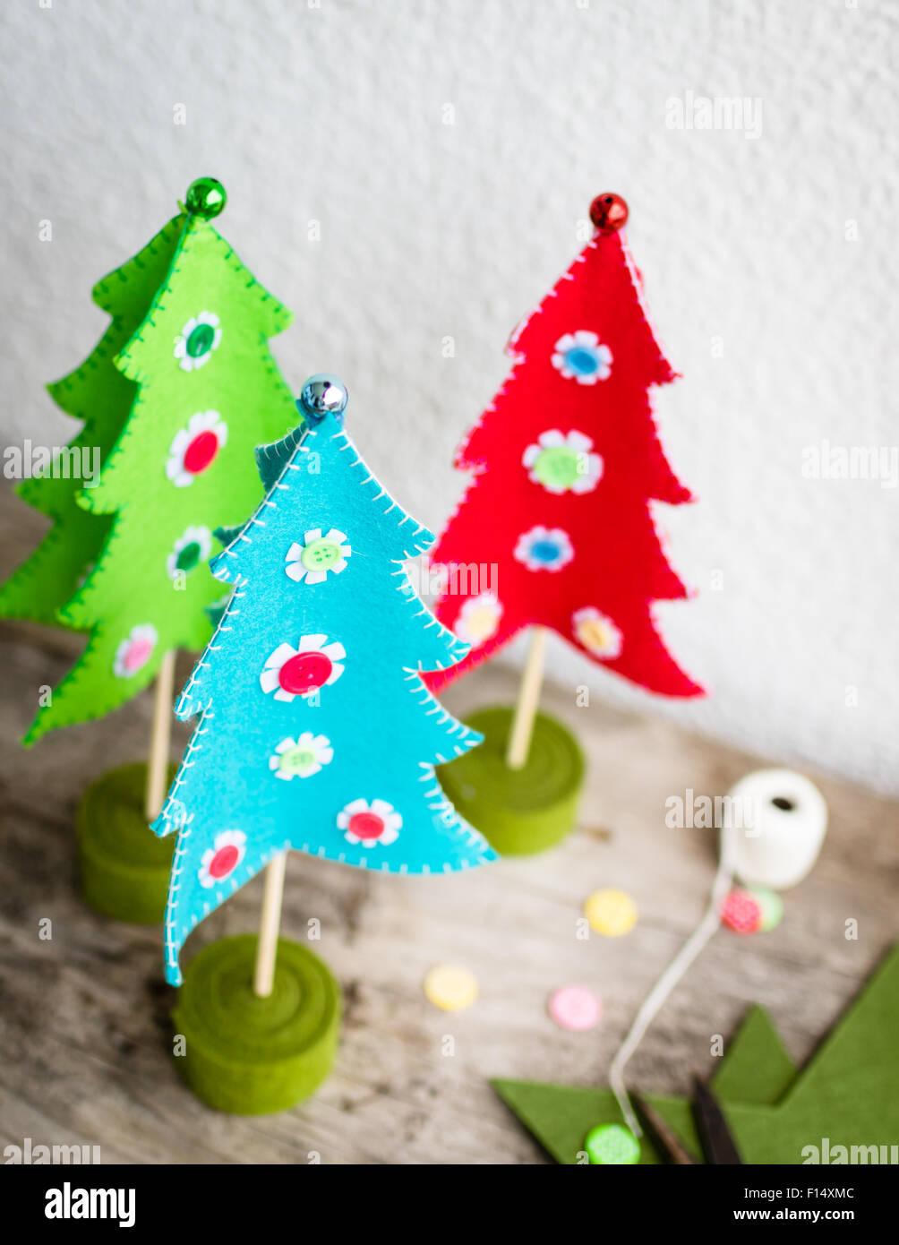 Handmade Colorful Felt Christmas trees, selective focus - Stock Image