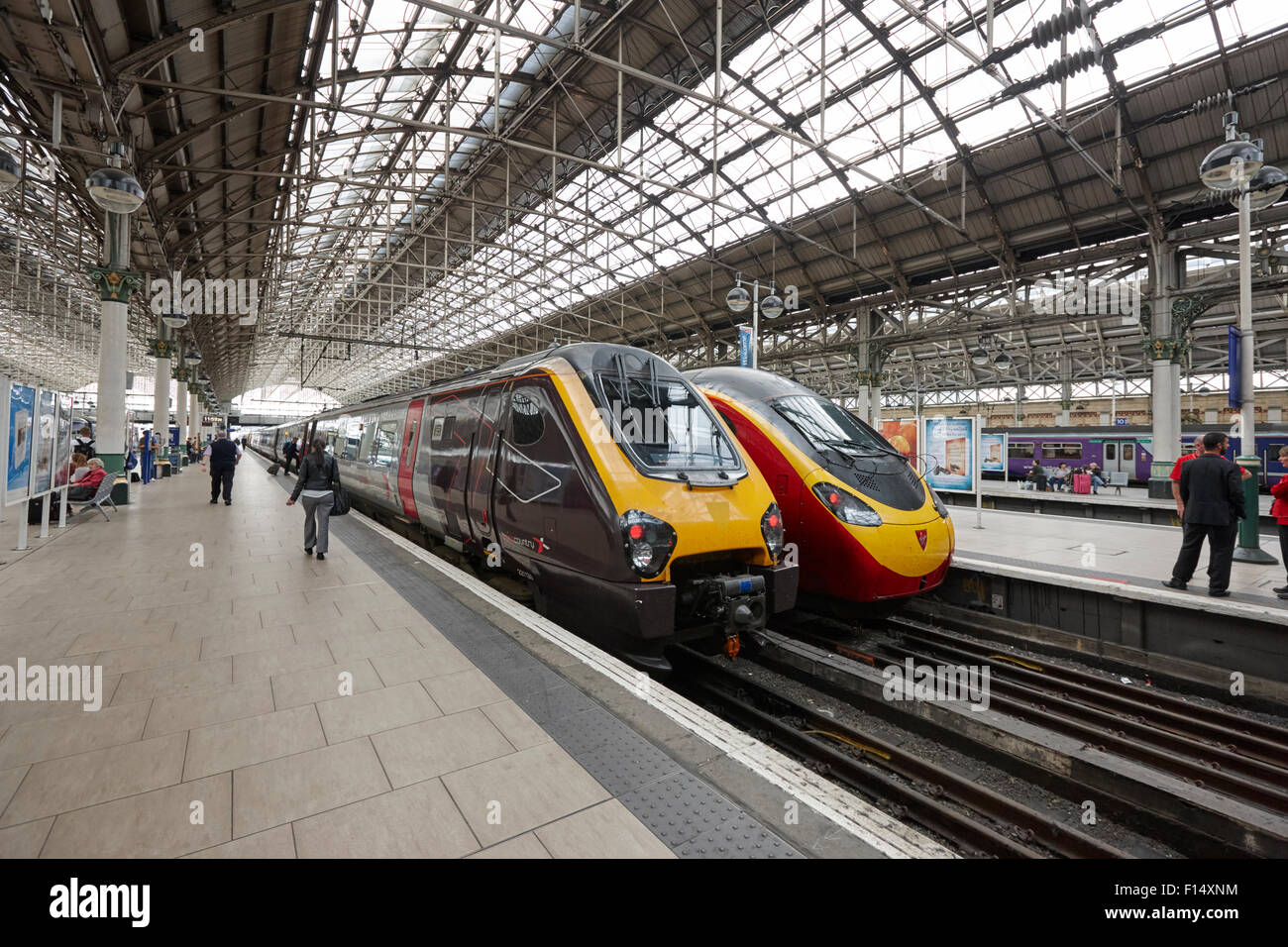 cross country and virgin pendolino trains at Piccadilly train station Manchester UK - Stock Image